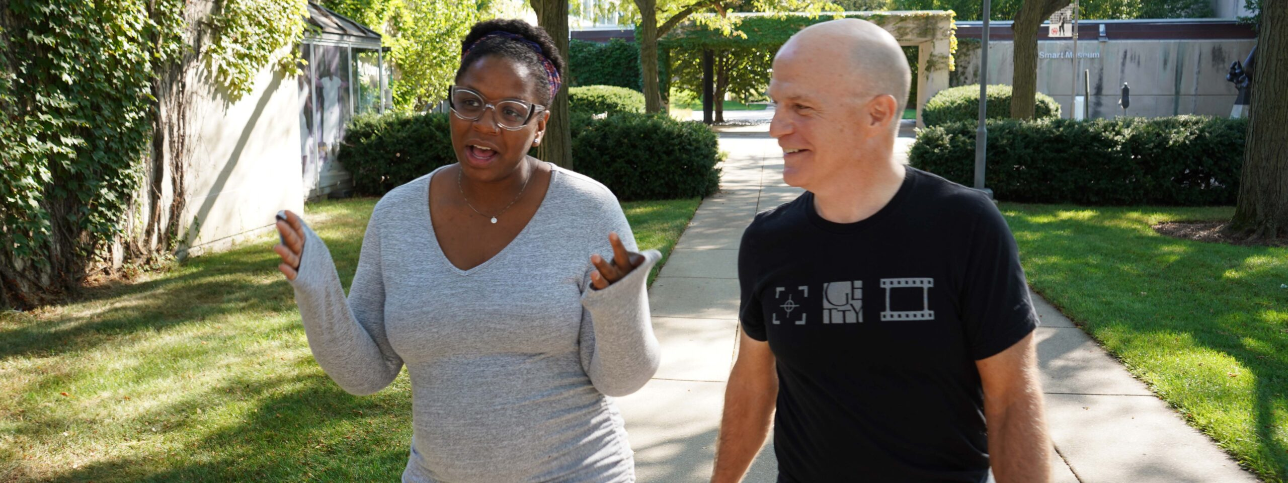 Gabrielle Randle-Bent and Charles Newell walking outside Court Theatre.